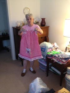 Janet Rolison showing one of the dresses she made that will be givien to a lucky child in Chiapas.